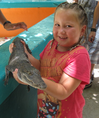 Mika holding a crocodile